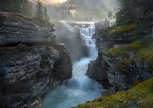 The cool waters of the Athabasca river in Jasper, Alberta on a misty morning.
